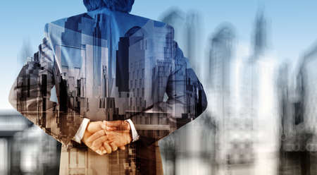 Double exposure of businessman and abstract city with blur background photo