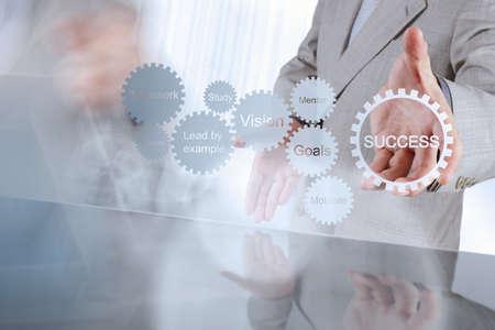 businessman hand shows gear business success chart concept Reklamní fotografie - 34871802