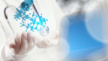 research worker: scientist doctor hand holds virtual molecular structure in the lab as concept