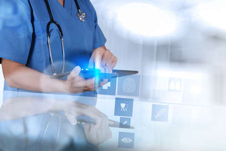 Medicine doctor hand shows tablet computer with medical computer interface as concept photo