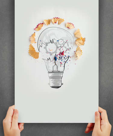 sharpen: hand drawing light bulb with pencil saw dust and gears icon on paper background as creative concept Stock Photo