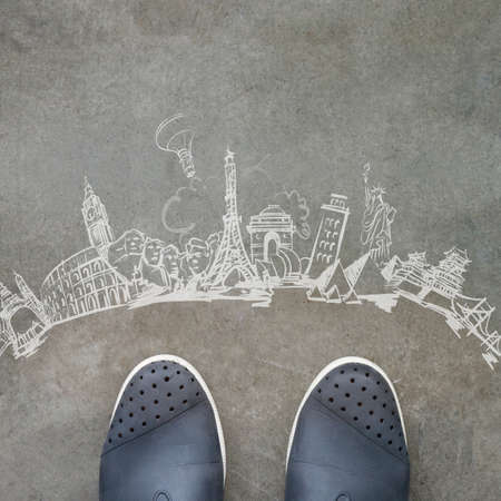 hand drawn traveling around the world on front of business man feet as concept Stock Photo