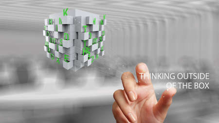 problemsolving: businessman hand shows word thinking outside the box as concept