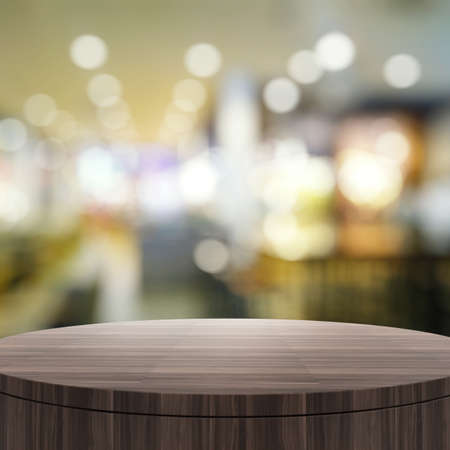 wooden surface: Empty wooden round table and blurred background for product presentation Stock Photo