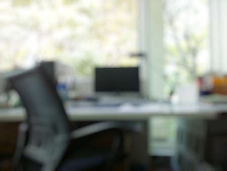 round table conference: abstract office with computer blur background