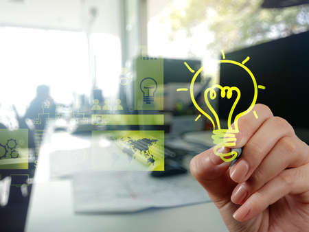 solutions icon: hand drawing creative business strategy with light bulb as concept