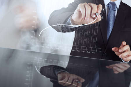 performances: businessman hand working with new modern computer and business strategy as concept Stock Photo