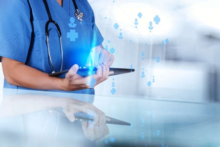 medical technology: smart medical doctor hand showing network with operating room as concept
