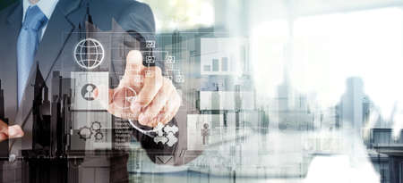human development: Double exposure of  businessman hand working with new modern computer and business strategy as concept Stock Photo