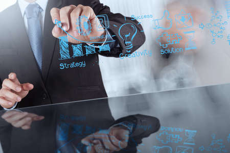 project: businessman hand working with new modern computer and business strategy as concept Stock Photo