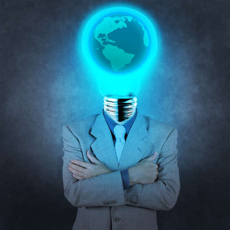 businessman with lamp-head and world inside concept on texture background photo