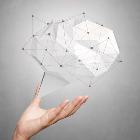 hand showing low poly geometric speech bubble with social media structure on white background photo