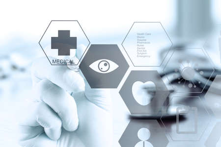 close up of Medicine doctor hand working with modern computer interface as medical concept