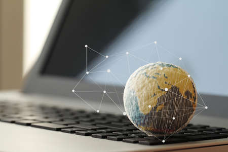the economy: hand drawn texture globe with social media diagram on laptop computer as internet concept Stock Photo