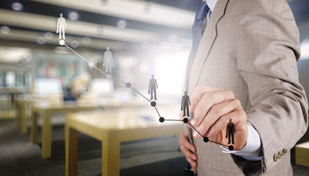 businessman hand working with new modern computer and business strategy as concept Stock Photo