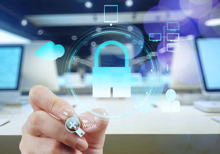 email security: businessman hand pointing to padlock on touch screen computer as Internet security online business concept and bokeh exposure