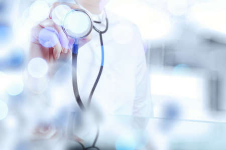 stethoscope: double exposure of success smart medical doctor working with abstract blurry bokeh  background as concept Stock Photo