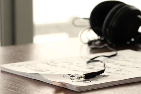 quavers: composing music concept with shallow DOF evenly matched jack of headphone and copy space