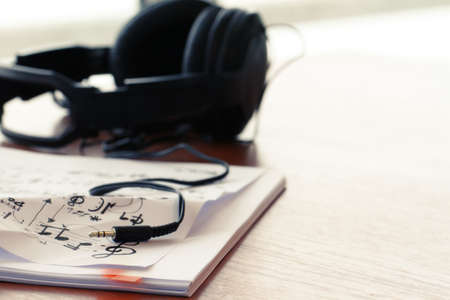 composing music concept with shallow DOF evenly matched jack of headphone and copy space photo