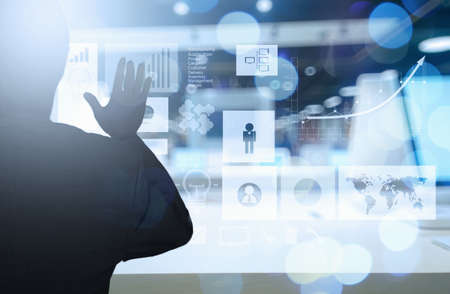 business goals: businessman hand working with new modern computer and business strategy as concept Stock Photo