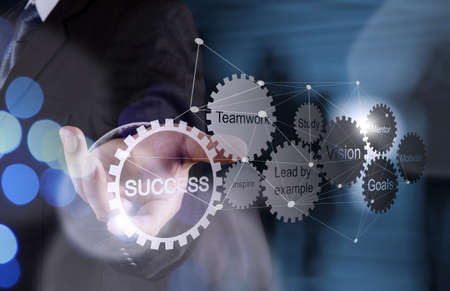Double exposure of businessman hand shows gear business success chart and network diagram