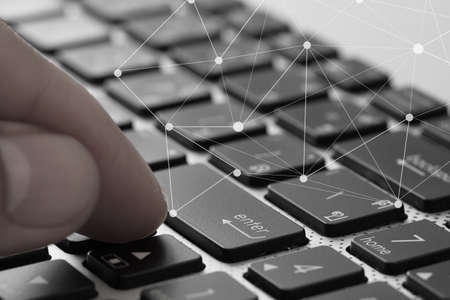 penfriend: close up of businessman finger use keyboard laptop computer with virtual social media diagram as concept