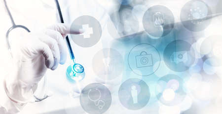 Medicine doctor hand working with modern computer interface as medical concept photo