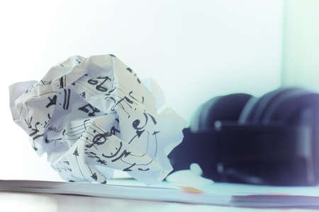 composing music concept with shallow DOF evenly matched crumpled musical notes paper photo