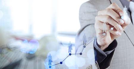 Double exposure of businessman hand choosing people icon as human resources concept Foto de archivo