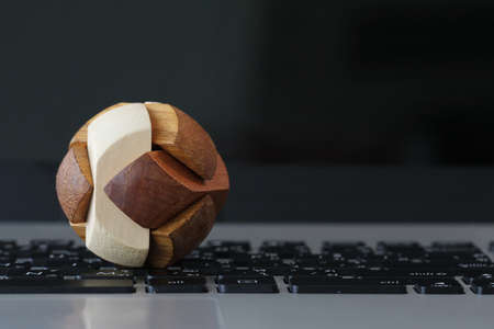 making earth: wooden texture globe puzzle on laptop computer as internet concept