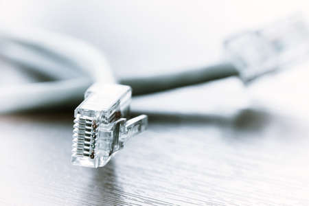telephone cable: close up of RJ45 Plug Lan Network on wood desk Stock Photo