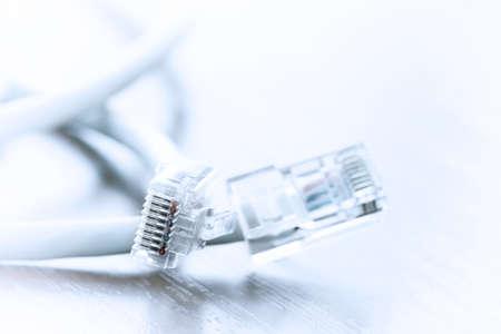 modem: close up of RJ45 Plug Lan Network on wood desk Stock Photo