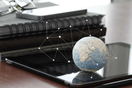 economy: hand drawn texture globe with blank social media diagram on digital tablet computer as internet concept and bokeh exposure