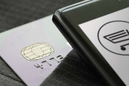 Credit cards in very shallow focus with gray suit background as online shopping concept