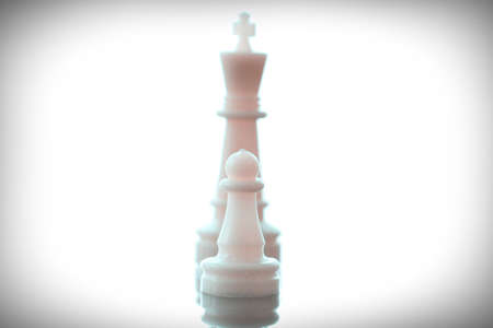 strong strategy: close up of king chess figure surrounded by a number of fallen black chess as strategy or leadership concept Stock Photo