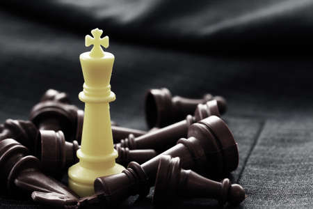 strong strategy: close up of chess figure on suit background strategy or leadership concept