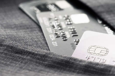 shallow focus: Credit cards in very shallow focus with gray suit background