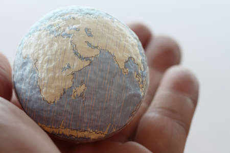 the global: close up of businessman hand showing texture the world concept Elements of this image furnished by NASA