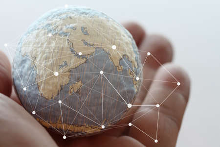 close up image: close up of businessman hand showing texture the world with digital social media network diagram concept Elements of this image furnished by NASA