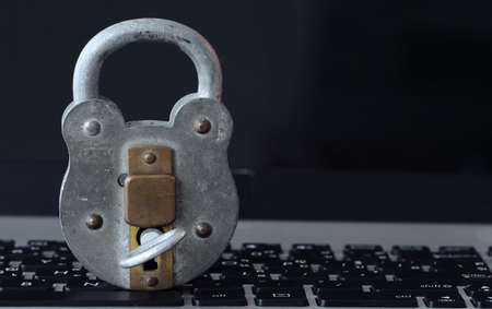 technology security: Internet security concept-old  padlock and key on laptop computer keyboard