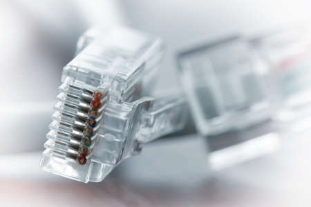 rj45: close up of RJ45 Plug Lan Network on wood desk Stock Photo