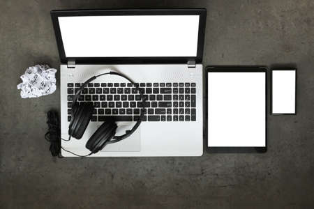 top view of workspace of composing music concept with headphone and blank screen computer laptop on texture desk background photo