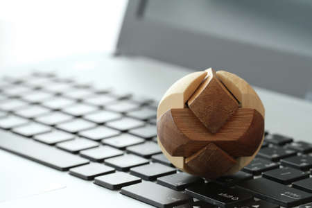 making earth: wooden texture globe with social media diagram on laptop computer as internet concept