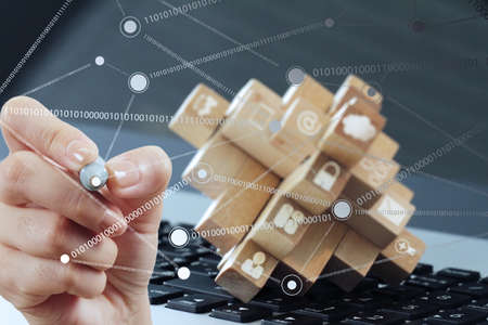 networking: close up of hand working with new modern computer show social network structure as concept Stock Photo