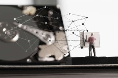 drafting table: Big data concept-miniature engineer working with drafting table with open hard disk and  social network diagram
