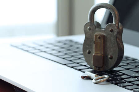 Internet security concept-old padlock and key on laptop computer keyboard photo