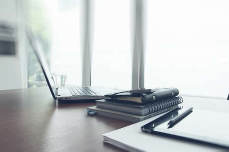 Office workplace with laptop and smartphone on wood table 写真素材