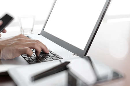 designer: Young creative designer hand working with laptop at office as concept Stock Photo