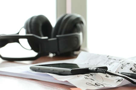 speaker phone: composing music concept with shallow DOF evenly matched jack of headphone and copy space