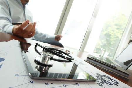 Doctor working with digital tablet and laptop computer in medical workspace office and medical network media diagram as concept photo
